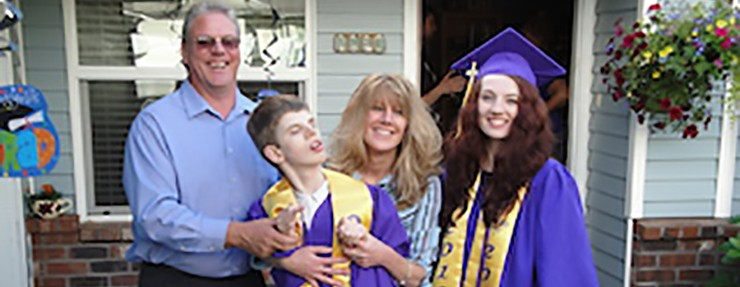 High school graduate with family