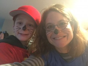 Nate and his mom dressed as cats for Halloween