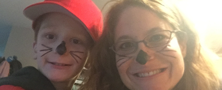 Mother and son dressed for halloween as cats
