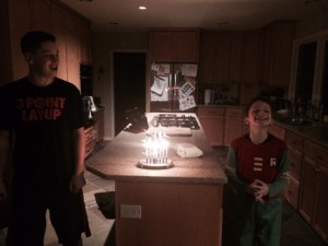 Nate and his brother with Chanukah candles