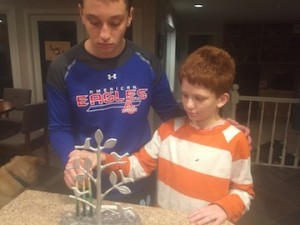 two brothers lighting the menorah