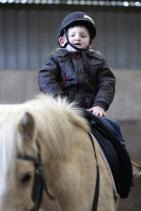 Boy with a disability riding a horse