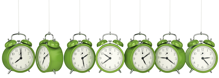 apple green clocks hanging from chains, each displaying a different time