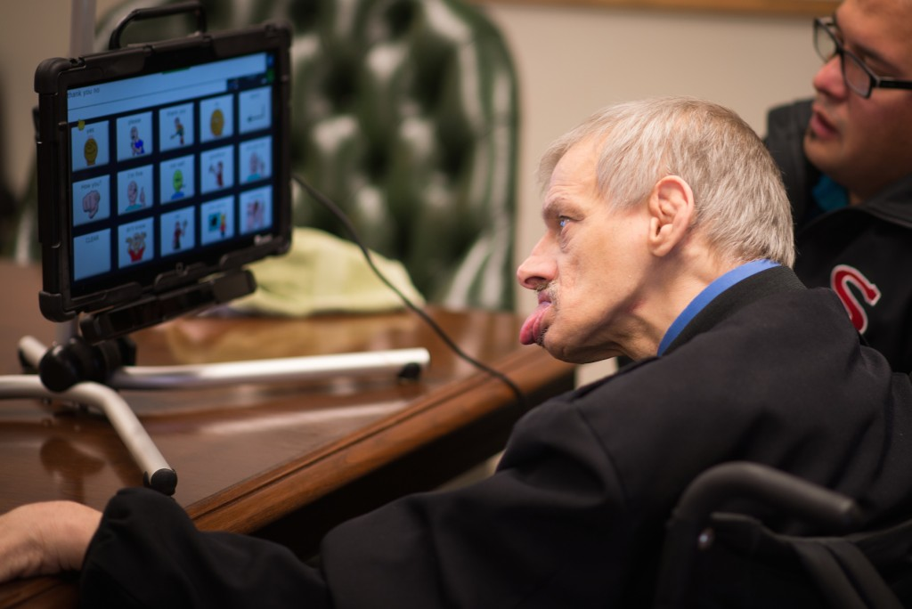man in wheelchair uses screen based picture software