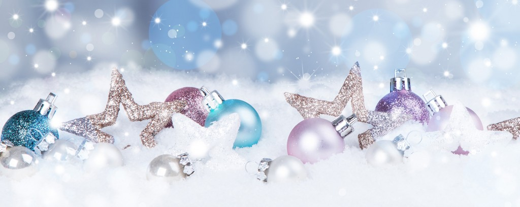 holiday background with blue baubles, snow and snowflakes,