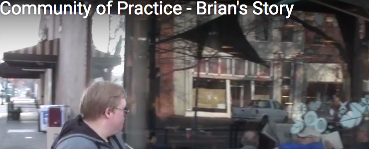 Screen shot from video, showing Brian walking outside a coffee shop. Video title reads: Community of Practice Brian's Story