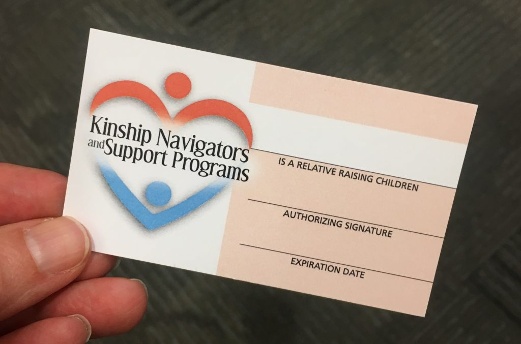 hand holding a blank Kinship Navigators and Support Programs card.