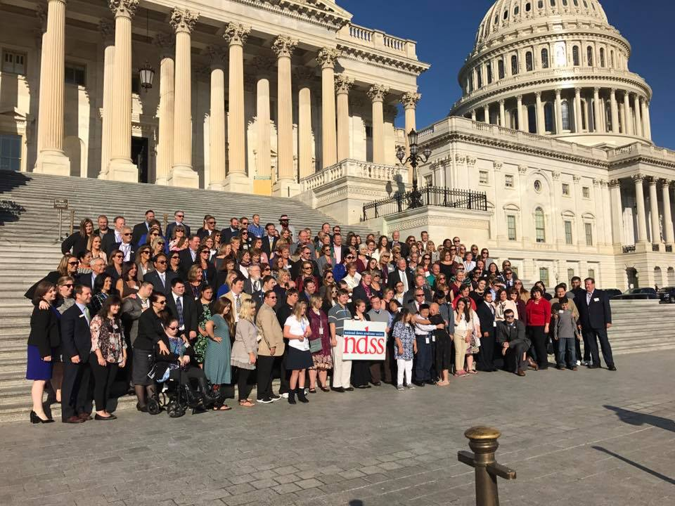 National Down Syndrome Society advocates stand outside capitol building in Washington DC.