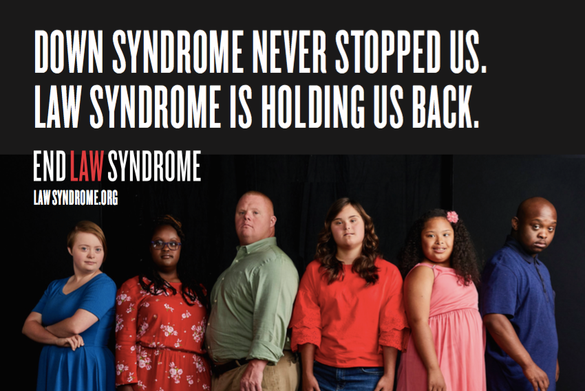 "#Law Syndrome campaign ad featuring six adults with Down syndrome standing against a black background. Text reads, ""Down syndrome never stopped us. Law syndrome is holding us back."""