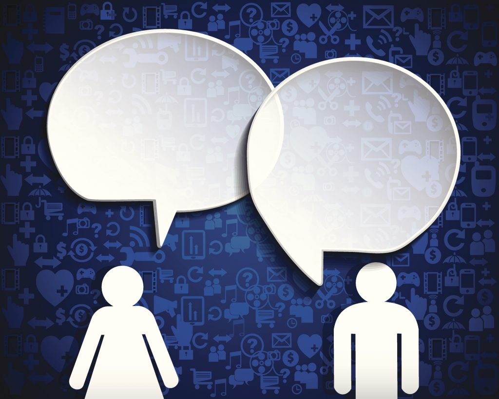 Man and woman with Paper speech bubbles.