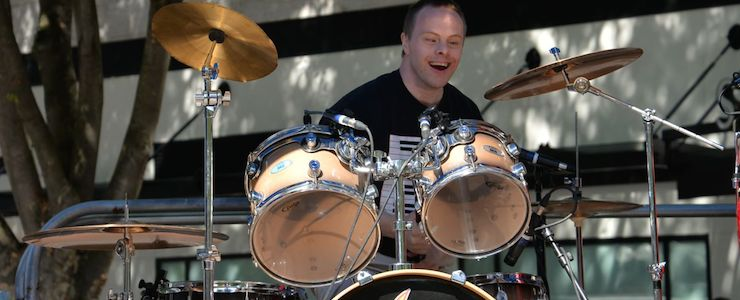 Drummer with Down syndrome at a public event.