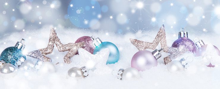 Christmas background with blue baubles,snow and snowflakes, free space for text. Christmas decoration.