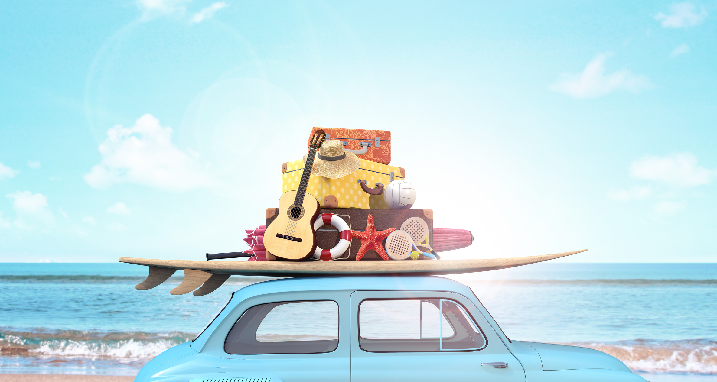 Car with luggage on the roof ready for summer vacation.