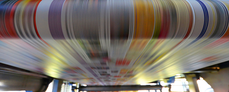 printing of colored newspapers with an offset printing machine at a printing press