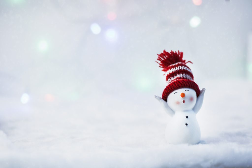 Happy snowman standing in winter christmas landscape. Merry christmas and happy new year greeting card. Funny snowman in hat on snowy background. Copy space for text (Happy snowman standing in winter christmas landscape.