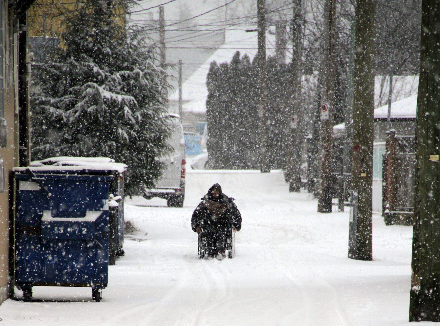 A man in a wheelchair during a Vancouver Snowstorm