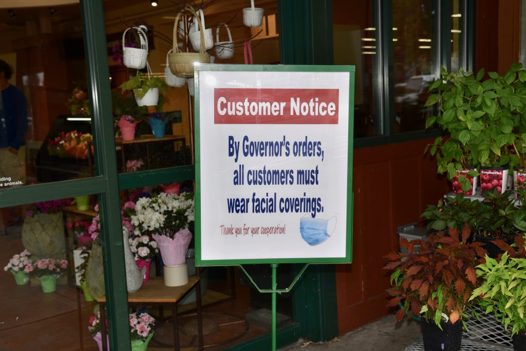 Notice of face covering requirement outside a grocery store.