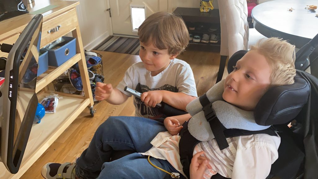 Jack and Charlie at home, playing game.