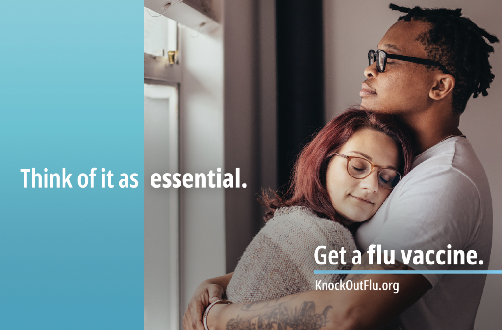 Man and woman holding each other. Text reads: Think of it as essential. Get a flu vaccine.