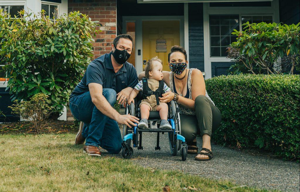 Stohr family outside, smiling, wearing masks.